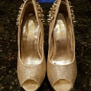 Gold glittery spiked heels